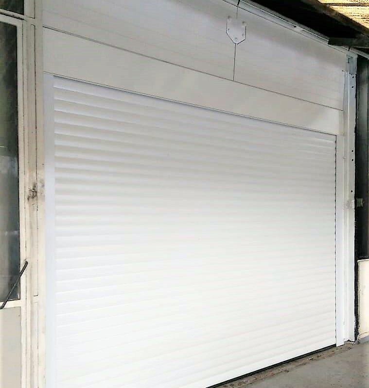 Portes de garage rénovation maison appartement zilten Ose Fermetures Artisan Menuiseries Extérieures1